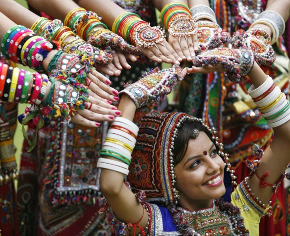 """A girl dressed in traditional attire poses as she takes part in rehearsals for the """"garba"""" dance ahead of Navratri festival in the western Indian city of Ahmedabad September 29, 2013. Navratri, held in honour of Hindu Goddess Durga, is celebrated over a period of nine days where thousands of youths dance the night away in traditional costumes. Navratri starts on October 5. REUTERS/Amit Dave (INDIA - Tags: RELIGION SOCIETY TPX IMAGES OF THE DAY)"""