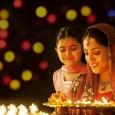 happy-diwali-indian-woman-lighting-diya