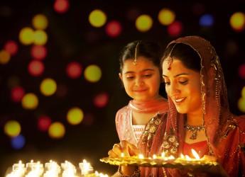 happy-diwali-indian-woman-lighting-diya